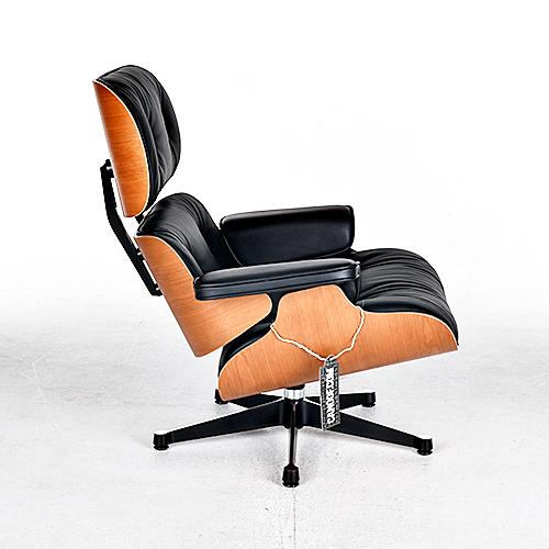 Charles Eames Vitra Bureaustoel.Vitra Eames Lounge Chair En Ottoman Kersenhout Amerikaans