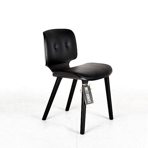 moooi nut stoel zwart leder